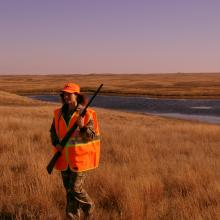 A woman grouse hunting
